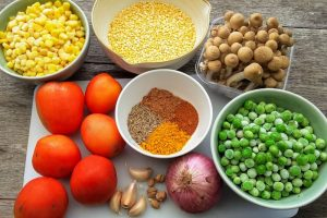 ingredients for tomato and split mung bean daal